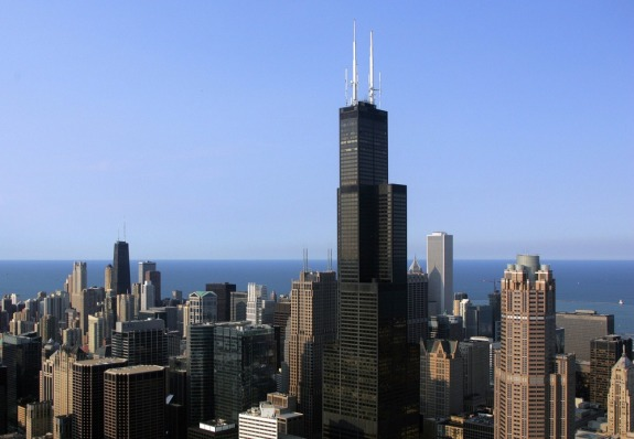 The Chicago skyline featuring the Sears Tower is seen from a helicopter 06 July 2006 in Chicago, Illinois. The tower, the tallest in North America was the tallest in the world until 1996. The tower is third behind the Petronas Towers in Malaysia. AFP PHOTO/TIM SLOAN (Photo credit should read TIM SLOAN/AFP/Getty Images)